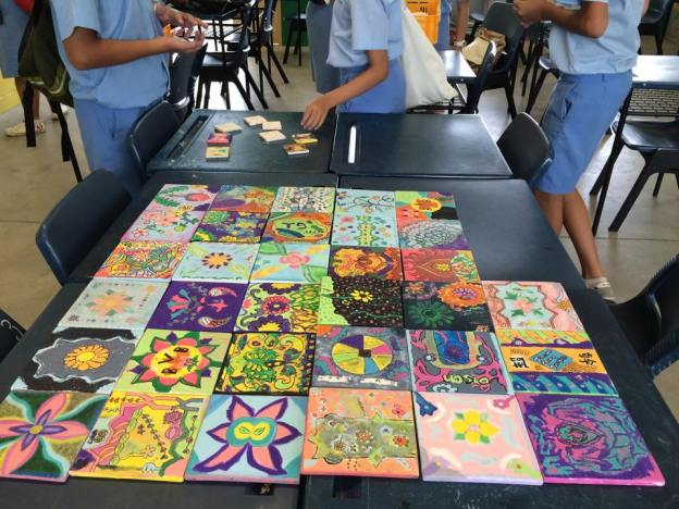 This is a 3 hours acrylic painting on ceramic tiles. The tiles will become part of a wall mural in the school wall.