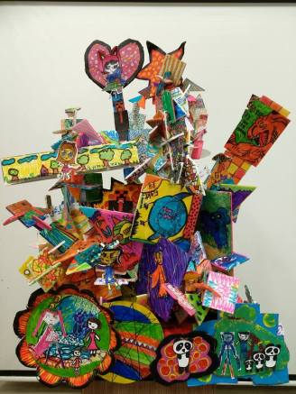 Every piece of card board that made up this towering 3D sculpture is designed and hand painted by the students
